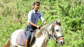Girl Rides Horse To Exam